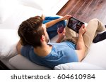 a young couple in the living... | Shutterstock . vector #604610984