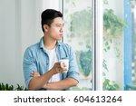 thoughtful asian man looking... | Shutterstock . vector #604613264