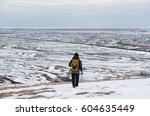 Backpacker Walking On Snow...