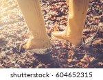 yellow boots walk in the dead... | Shutterstock . vector #604652315