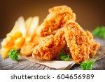 Fried Chicken Wings On Wooden...
