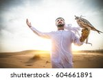 arabian man walking  in the... | Shutterstock . vector #604661891