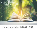 opened up of book on wooden... | Shutterstock . vector #604671851