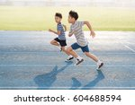 Young Asian Boy Running On Blue ...