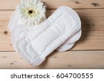 the sanitary napkin lying on a... | Shutterstock . vector #604700555