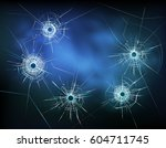 bullet holes in glass with...