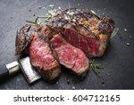 barbecue aged wagyu rib eye... | Shutterstock . vector #604712165