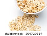 food. oatmeal on the table. dry ... | Shutterstock . vector #604720919