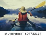 a woman sea kayaking on the... | Shutterstock . vector #604733114