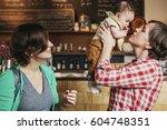 two women  a same sex couple... | Shutterstock . vector #604748351