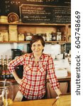 a woman in a coffee shop behind ... | Shutterstock . vector #604748669