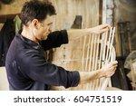 man standing in a carpentry... | Shutterstock . vector #604751519