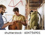 two men in a cycle repair shop  ... | Shutterstock . vector #604756901