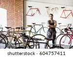 a man working in a bicycle... | Shutterstock . vector #604757411