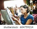 woman standing in a shop... | Shutterstock . vector #604759214