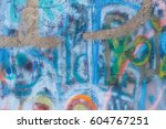 Small photo of A wall daubed with colourful paint, graffiti, street art, close up