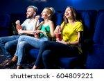 happy friends watching film... | Shutterstock . vector #604809221
