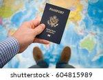 man's hand holding us passport. ... | Shutterstock . vector #604815989