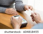 hand with credit card swipe... | Shutterstock . vector #604818455