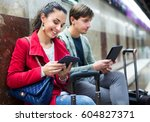 subway passengers reading with... | Shutterstock . vector #604827371