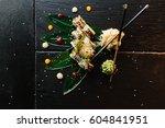 sushi rolls on black stone... | Shutterstock . vector #604841951