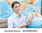 Small photo of Young Woman Travel Agent Concept