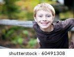 Portrait Of A Cute Young Boy...