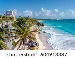 Ruins of Tulum, Mexico and a palm tree overlooking the Caribbean Sea in the Riviera Maya