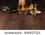 money and whiskey on wooden... | Shutterstock . vector #604927121