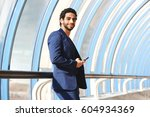 portrait of arab man in a suit... | Shutterstock . vector #604934369