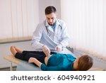 the doctor examines the patient. | Shutterstock . vector #604940921