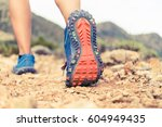 hiking or running woman in... | Shutterstock . vector #604949435