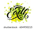 hand sketched text 'happy earth ... | Shutterstock .eps vector #604950215