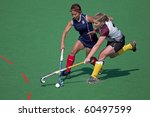 BLOEMFONTEIN, SOUTH AFRICA - AUGUST 7: Unidentified players during a women's field hockey match between the North West and Free State Universities, on Aug 7., 2010 in Bloemfontein, South Africa. - stock photo