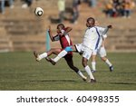 BLOEMFONTEIN, SOUTH AFRICA - AUGUST 7: Unidentified players during a men's soccer match between the North West and Free State Universities, on Aug 7, 2010 in Bloemfontein, South Africa. - stock photo