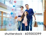 girl with gift box running in... | Shutterstock . vector #605003399