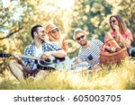 happy young friends having... | Shutterstock . vector #605003705