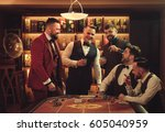 group of men playing poker in... | Shutterstock . vector #605040959