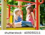 two cute little girls having... | Shutterstock . vector #605050211