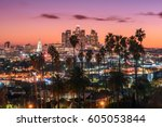 Stock photo beautiful sunset of los angeles downtown skyline and palm trees in foreground 605053844