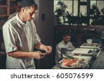 two young white chefs dressed... | Shutterstock . vector #605076599
