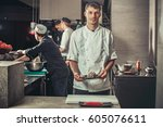 food concept. one young chef... | Shutterstock . vector #605076611