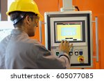 cnc machine operator. engineer... | Shutterstock . vector #605077085