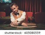 croupier behind gambling table...   Shutterstock . vector #605080559