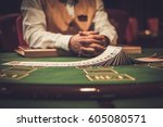 croupier behind gambling table... | Shutterstock . vector #605080571