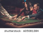 upper class friends gambling in ... | Shutterstock . vector #605081384