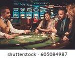 upper class friends gambling in ... | Shutterstock . vector #605084987