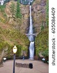 Small photo of Multnomah Falls and its viewing area including a lighted lamp. The two tiered 611 foot waterfall (542 upper & 69 lower) is along the Columbia River Gorge 30 minutes east of Portland, Oregon.
