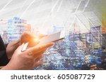 businessman holding smart phone ... | Shutterstock . vector #605087729