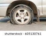 burst tire on the road | Shutterstock . vector #605130761